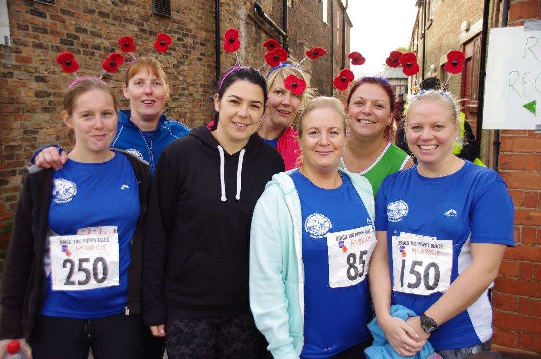 Runners with their running shirts and poppy headdress taking part in the Brigg 10k poppy race